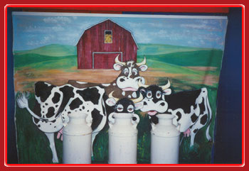 Carnival event Milk jugs with a cow background