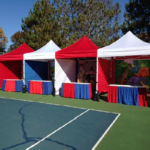 Outdoor carnival event red and white tents
